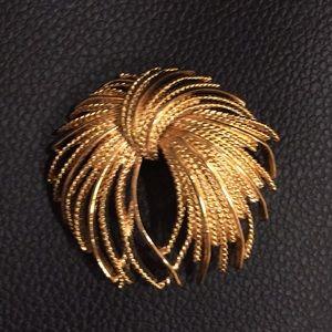 Monet Mirador fireworks gold tone brooch